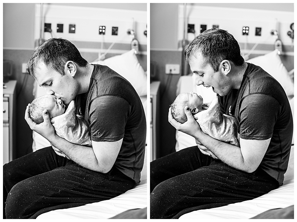 New dad kisses his baby. Fresh 48 session by Belligham photographer Renee Bergeron.