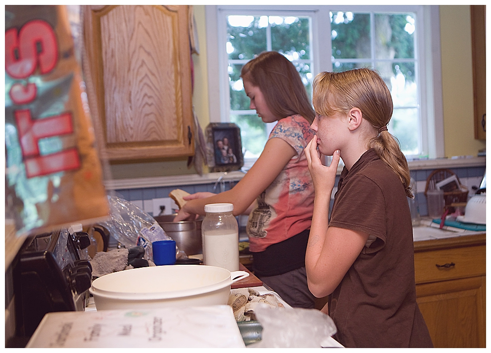 Sisters making dinner during their mom's labor at home.