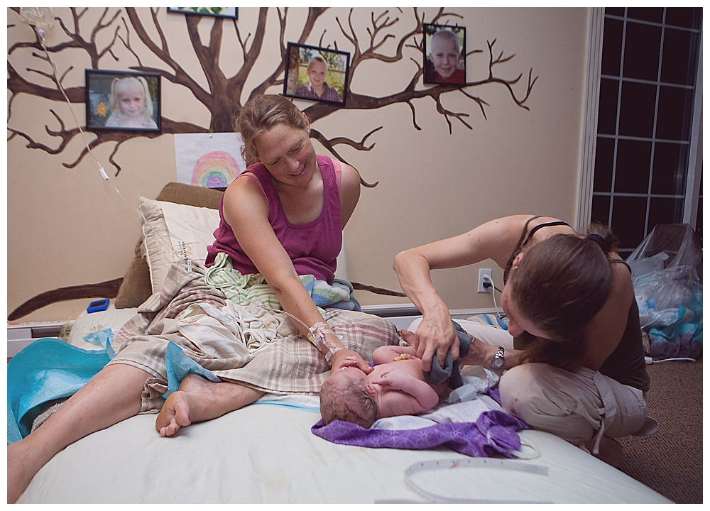 Mom examines baby after her homebirth in Lynden.
