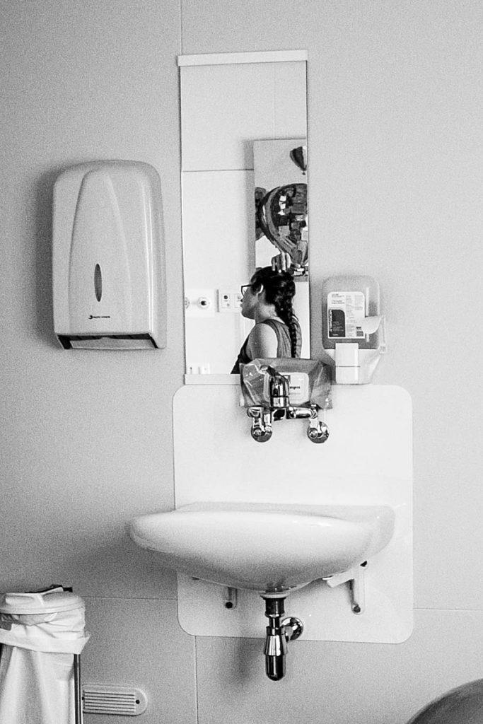 Mirror photo of mom giving birth. VBAC.