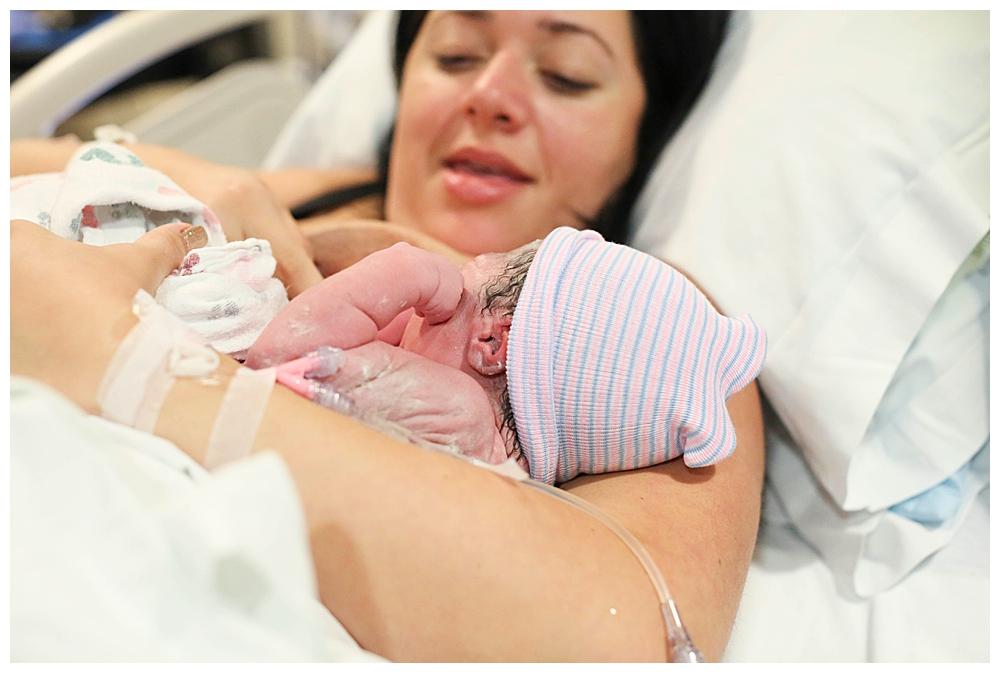Newborn baby, minutes after birth. Renee Bergeron Bellingham birth photographer.