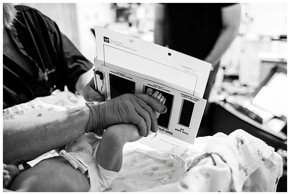 Baby getting footprints after birth.