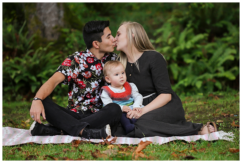 Mixed race couple kissing. Bellingham photographer Renee Bergeron of Little Earthling Photographer.