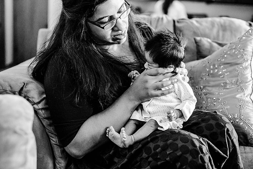 Mom burping newborn baby. Bellingham, WA