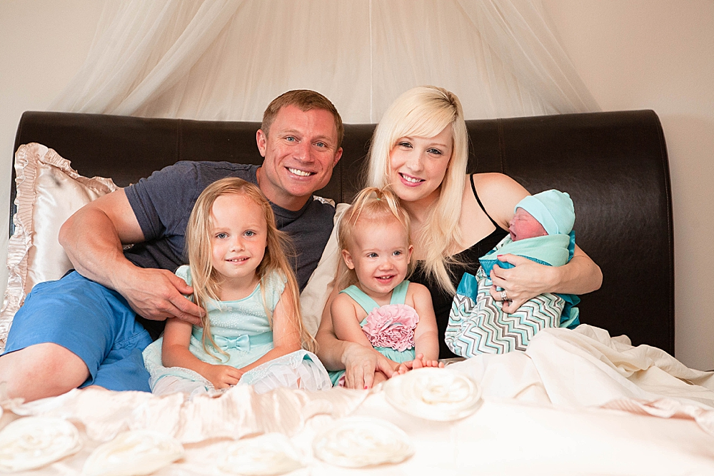 Happy family smiling after family-centered homebirth