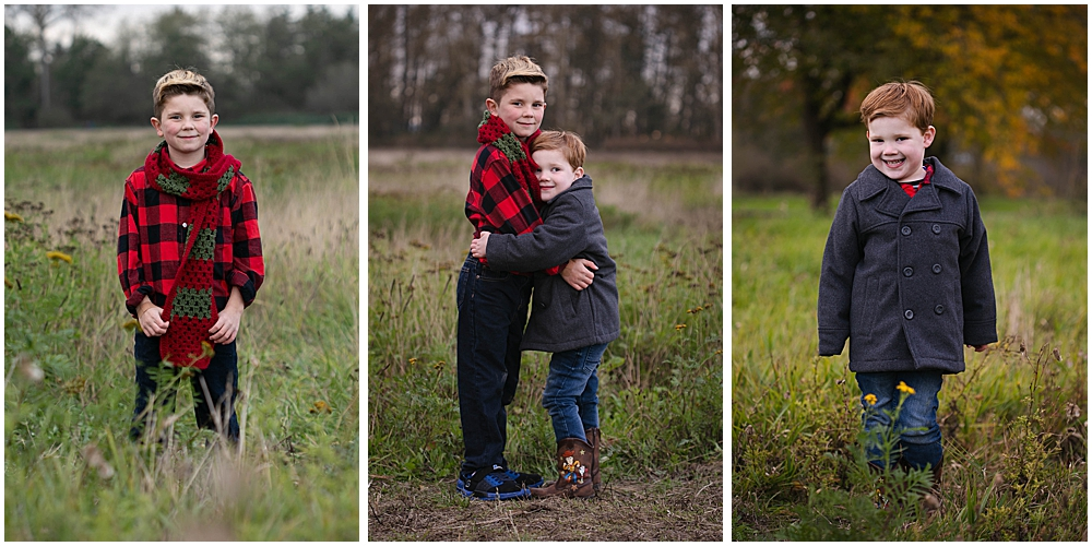 Little boys hugging in field of grass.