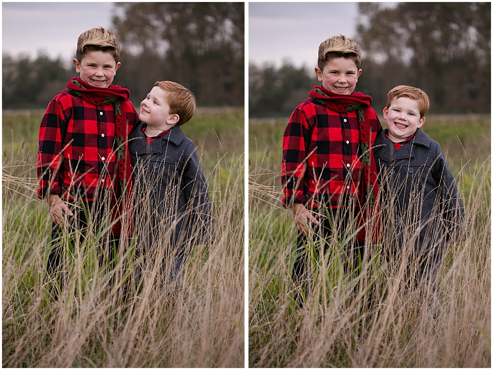 Brothers hugging in hay field.