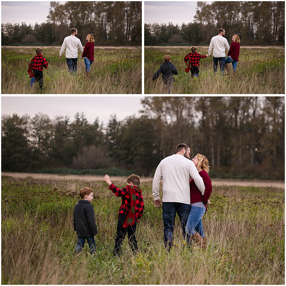 Family playing in hayfield during family photo session.