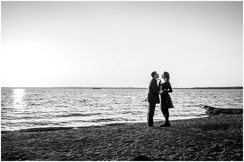 Sillouette of couple on the beach at boulevard park. engagement photos