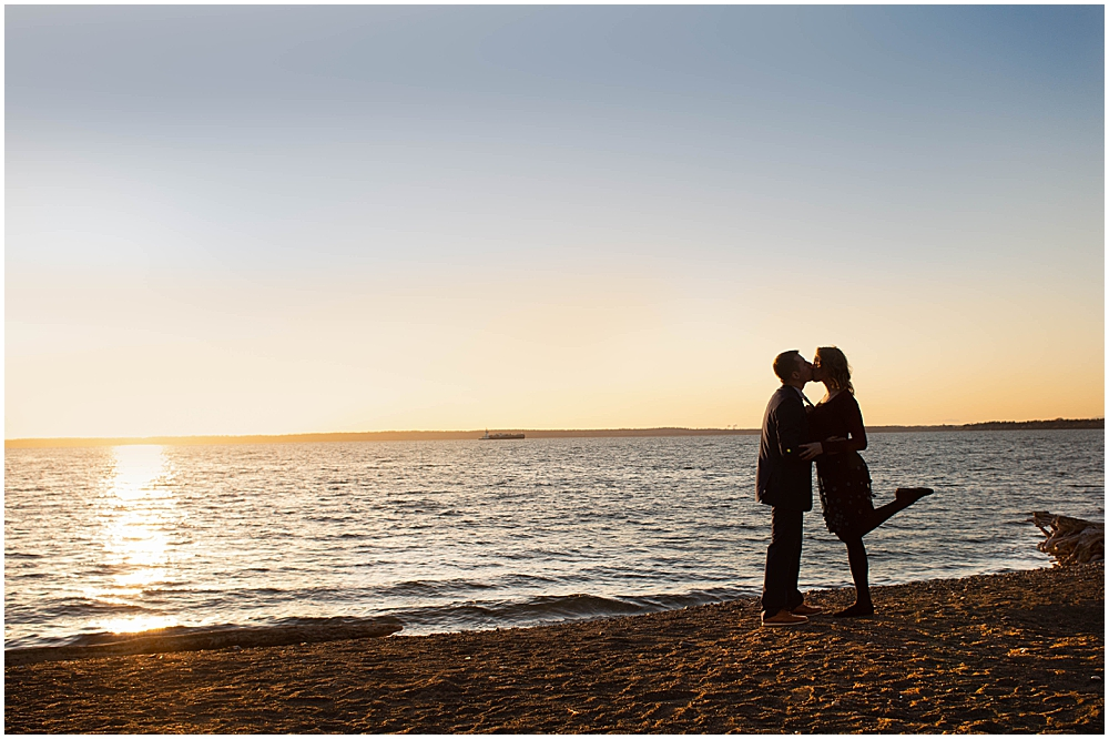 Couple on the beach at boulevard park at sunset