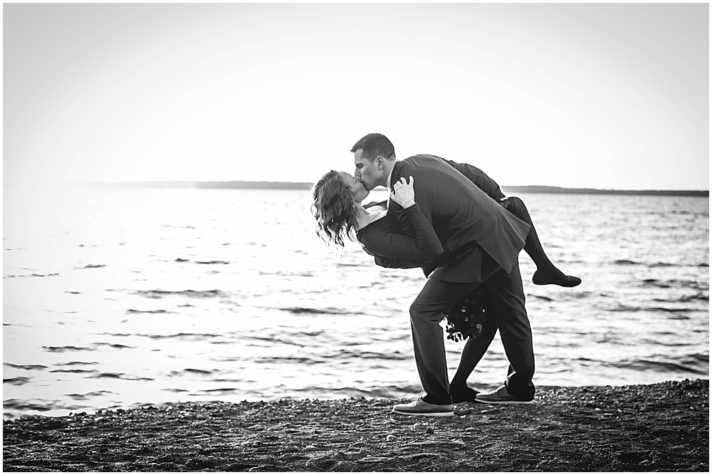 Couple kissing on a beach at sunset. boulevard park engagement photos.